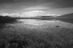 Riflessi del Vettore (luca_pictures) Tags: travel sunset bw italy snow mountains water beauty grass reflections spring outdoor plateau umbria openair sibillini vettore castellucciodinorcia parconazionaledeimontisibillini piangrande puddleofwater