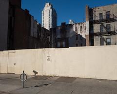 Post No Bill (UrbanphotoZ) Tags: nyc newyorkcity ny newyork fence construction shadows manhattan sidewalk firstave eastside plywood bikerack apartmentbuildings postnobill