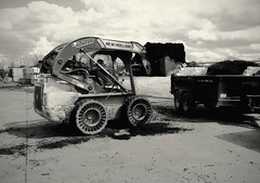 -WORK- (K.Chris ~AlwaYs LeaRning~) Tags: camera blackandwhite bw black ford field clouds yard truck work lens grey construction flickr day employment soil april vehicle trailer bobcat mulch towmotor