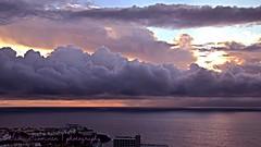 Purple rain (suominensde) Tags: ocean sunset sky espaa cloud seascape building sol del landscape mar seaside los spain nikon purple outdoor horizon atlantic shore cielo tenerife puesta nube atlntico horizonte oceano gigantes d3100