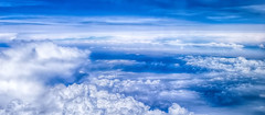 over the clouds.... (frederic.gombert) Tags: world blue light sky cloud sun seascape color colors clouds plane dark landscape earth flight