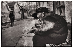 China003 (siggi.martin) Tags: china people man men asia asien sitting beijing menschen smoking lane mann peking mnner gasse rauchen sitzen houtong