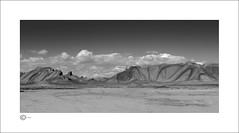 Ash Riding (Clicker_J) Tags: lighting light bw detail rock stone clouds landscape blackwhite nikon shadows patterns dunes shapes rocky naturallight ash swirl dust nationalparks eastern highlight