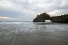 Tanah Lot Temple (adamraufz.inc) Tags: ocean old travel sunset red sea sky bali cliff sun building history nature water beautiful silhouette architecture clouds indonesia landscape religious island temple evening asia sundown traditional religion scenic culture dramatic lot peaceful wave landmark holly exotic tropical mystical oriental hindu majestic hinduism pura tropics indonesian tanahlot tanah balinese