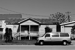 House for Sale. (Greyframe) Tags: road park street old sea blackandwhite usa white house galveston bus broken monochrome beautiful car sign contrast carpet lost blackwhite texas village sale side porch parked sight rotten terminator cleaner schwarzweiss ghostbuster greyframe parkology