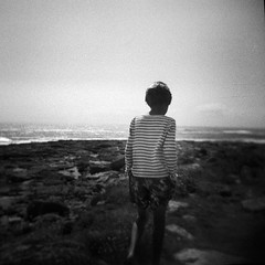 The first time I read that as a little boy, I wanted to meet Captain Nemo. (jean-christophe sartoris) Tags: boy portrait blackandwhite seascape analog back holga noir child et blanc holydays filmphotography