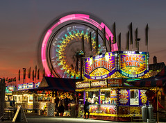 Wyoming MI - Carnival (Kevin Povenz) Tags: longexposure carnival sunset sky lights ride michigan fair flags april ferriswheel wyoming vender 2016 westmichigan kentcounty canon7dmarkii