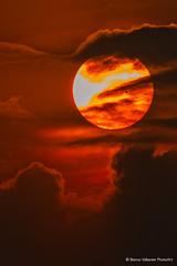 Low sun (BiancaValkenierPhotoArt) Tags: sunset red sky sun nature clouds evening cloudy wolken sunspot zon eveninglight lowsun avondzon zonnevlek laagstaandezon bewolk