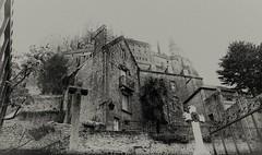 Le Mont Saint-Michel (Missy Jussy) Tags: trip bw france monochrome cemetery graveyard architecture canon buildings mono blackwhite moody gates atmosphere spooky monastery historical normandy gravestones lemontsaintmichel cannon600d