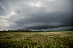Supercell over the Foothills (Kirby Wright) Tags: road blue cloud mountain mountains oklahoma rain hail wall clouds alley nikon texas open path wildlife shelf dirt bands chase rotation thunderstorm tornado wichita f28 core shaft panhandle chasing refuge manfrotto chaser supercell 14mm inflow mesocyclone rokinon d700 asperatus