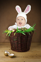 Funny Easter bunny in the basket (Elena Yakimova) Tags: pink baby brown white color rabbit bunny green broken colors smile grass vertical easter fun happy golden wooden spring funny holidays child basket floor nest traditional joy shell ears celebrations smiley surprise eggs richness greetings cheerful plank cracked wickerwork