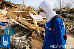 IRUSA disaster response team member looks at the devastation that was created by the tornado.