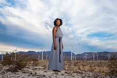 GBI_4193 (GBImaging) Tags: california blue portrait sky woman mountains windmill cali lady female clouds photo model sand energy rocks power dress desert sandiego picture pic professional ambient greenpower gbimaging gbimaging7