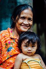 Grandmother & Grand Daughter, Cebu City Philippines (AdamCohn) Tags: smile grandmother philippines grandchild cebu filipina cebucity adamcohn wwwadamcohncom