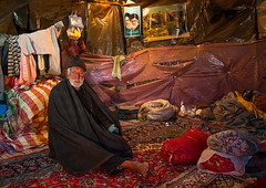 old man in his troglodyte house, Kerman province, Meymand, Iran (Eric Lafforgue) Tags: winter people house man cold men heritage tourism archaeology horizontal stone architecture underground carpet asia sitting village iran persia architectural historic unescoworldheritagesite indoors human cave adults residential ancientcivilization troglodyte thepast adultsonly cultural oneperson middleeastern traditionalculture rockformation menonly seniorman archaeologicalsite traveldestinations  fulllenght onemanonly  touristdestination 1people  iro  builtstructure residentialstructure maymand meymand colourpicture humansettlement kermanprovince  irandsc07905