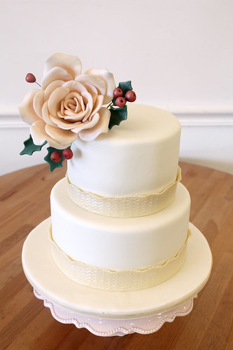 Winter Wedding cake With Peach Rose and Holly Berries
