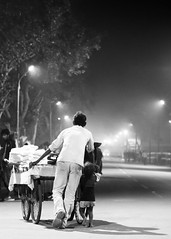 Father and Daughter (Capturing desire) Tags: road street light blackandwhite monochrome streetlight mood father daughter fair cart allahabad fatherslove longroadahead maghmela streetsofallahabad