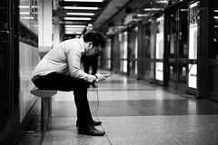 4 (ah.b|ack) Tags: street bw station zeiss t 50mm singapore bokeh body sony 4 posture mrt handphone wideopen f15 sonnar zm a7ii zeisscsonnart1550mmzm a7mk2