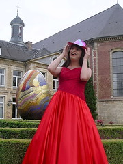 Red hat (Paula Satijn) Tags: red castle girl hat lady garden easter outside shiny dress egg silk skirt class tgirl tranny transvestite gown satin gurl elegance ballgown