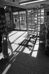 Honest Ed's (Georgie_grrl) Tags: light shadow blackandwhite signs toronto ontario monochrome store entrance pentaxk1000 exit turnstile honesteds bloorstreetwest ilford400asa rikenon12828mm