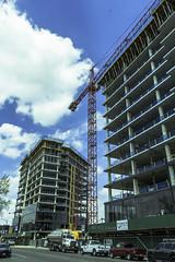 Construction on Milwaukee Ave. pic25 4-25-2016 (Artemortifica) Tags: street bridge sky chicago cars clouds buildings construction blueline crane bikes graffity milwaukee western trucks damen
