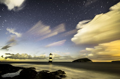 Penmon (Glen Parry Photography) Tags: longexposure nightphotography sea lighthouse beach night clouds stars star coast nikon rocks seascapes blackpoint anglesey northwales penmon