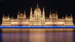 Budapest (GrandJr) Tags: city longexposure building night river 50mm golden nikon waves 14 ngc budapest parliament nd pro mirrored fx danube d3 ais hoya nd8 grandjr