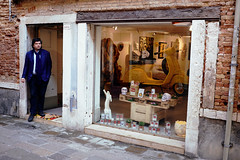 special assortment (f/.M) Tags: venice italy shop person skull store vespa candid streetphotography documentary fujifilm venezia venedig geschft x100t