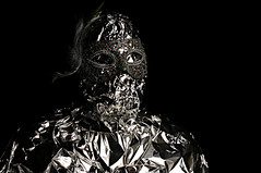 She wanted her portrait taken, but she didn't want to be recognized (Studio d'Xavier) Tags: portrait silver mask foil anniversary surrealism surreal silvery strobist werehere happyanniversaryzenas