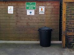 school smoking area (maximorgana) Tags: wood english sign wall yard poster board courtyard dirty bin tip font fag cigarrette trashbit