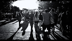 Evening on the Town (Anne Worner) Tags: people blackandwhite bw sun walking outside outdoors evening lowlight texas candid wideangle georgetown ricohgr contrejour strongcontrast streetstreetphotography silverefex anneworner 2016poppyfestival