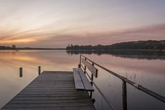 Morgens am Westensee II (rahe.johannes) Tags: see wasser wolken bank sonnenaufgang spiegelung schleswigholstein steg langzeitbelichtung badesee wolkenstimmung badesteg