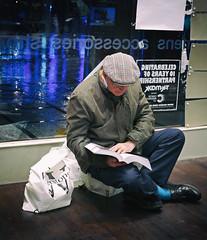Consumer Fatigue (Dave_Davies) Tags: christmas man shopping book sit rest sales fatigue consumer shopper