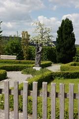 Spring has sprung (dididumm) Tags: tree green art statue clouds fence spring kunst wolken grn zaun baum frhling blooming blhen