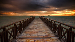 Comtemplation (Israel DeAlba) Tags: ocean wood sky beach colors yellow sunrise pier dock nwn