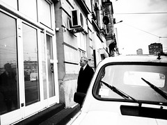 DIGITAL SELF TALK (Galantucci Alessandro) Tags: street city portrait people blackandwhite bw white black monochrome contrast photography monocromo town eyecontact europe strada gente candid serbia streetphotography documentary east persone grainy belgrade fotografia bianco ritratto nero biancoenero citt contrasto fotografiadistrada documentaristica