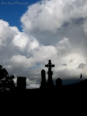 Glenwood Cemetery (Gerri Gray Photography) Tags: ny newyork cemetery grave graveyard silhouette clouds cross cloudy headstone tomb upstate graves glenwood gravestone tombstones madisoncounty oneida gravemarker taphophilia
