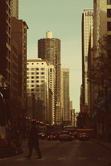 (eflon) Tags: street city chicago man bus person illinois warm downtown il tones bldgs