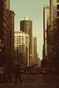 (eflon) Tags: street city chicago man bus person illinois warm downtown il tones bldgs
