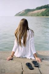 Free Spirit (//rusty//) Tags: woman white lake color water girl female youth 35mm concrete pier model minolta kodak michigan adventure negative shore expired solitary selfprocessed portra c41 maxxum7 160nc 50mmf17 diycolor epsonv500