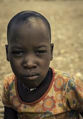 Ovahimba Stare Down (Baron Reznik) Tags: africa portrait look vertical kid model child african traditional tribal afrika tribe ethnic namibia everydaylife kaokoveld afrique  kaokoland colorimage kunene indigenouspeoples    ovahimba canon50mmf12l himbapeople omuhimba    republicofnamibia
