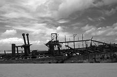 Maheno wreckage (PhillMono) Tags: ocean new cloud white storm black heritage history beach monochrome sepia island boat sand rust ship union australia vessel olympus line zealand shipwreck queensland hull fraser dslr wreck shattered sinking e30 liner maheno