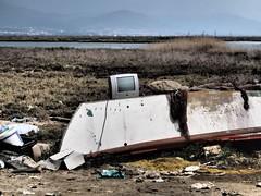 near Kalochori (Nikos Karatolos) Tags: kalochori thessaloniki greece seafront waterfront sea sand tv television rubish garbage abandoned boat