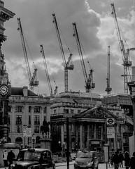 And Stretch, Two, Three, Four... (bjg_snaps) Tags: city urban bw white black building london architecture construction cab taxi cranes textures busy layers bustling