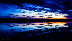Colors of the evening (Jani Mkel) Tags: blue sunset sky orange reflection eye nature water colors night clouds canon finland dark landscape photography eos mirror evening photo spring twilight colorful long exposure photographer view purple candy dusk horizon wideangle calm clear shore after nightsky finnish efs atmospheric accurate identical lightroom precise canonphotography 700d