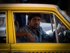 Taxi Driver (Capturing the Sensorial) Tags: travel red portrait people man yellow iran taxi persia olympus backpacking kashan 75mmf18 omdem5