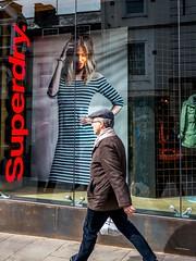 Flat Cap (Silver Machine) Tags: street man window girl sunglasses lumix outdoor candid coat streetphotography windsor windowdisplay berkshire flatcap lumixg lumixg20mmf17 lumixg5