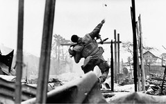 U.S. Marine throwing a hand grenade Battle of Hu, Vietnam, 1968. (Peer Into The Past) Tags: history usmc photojournalism vietnam marines 1968 hue marinecorps semperfi handgrenade vietnamwar donmccullin warphotography deltacompany 5thmarines peerintothepast selwyntaitt