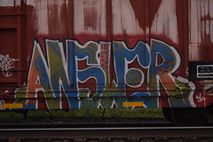 ANSWER (TheGraffitiHunters) Tags: street blue red white black green art car train graffiti colorful paint box tracks spray boxcar freight answer benched benching