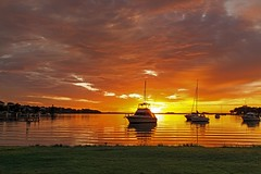 Eye of the Sun (Sterling67) Tags: reflection water clouds sunrise pier stormy yachts lakemacquarie wangi